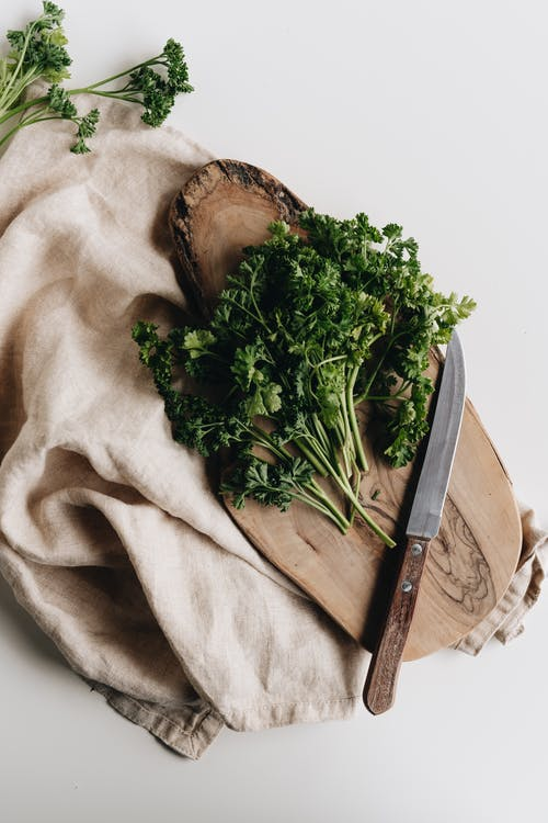 Photo Of Parsley On Wooden Chopping Board