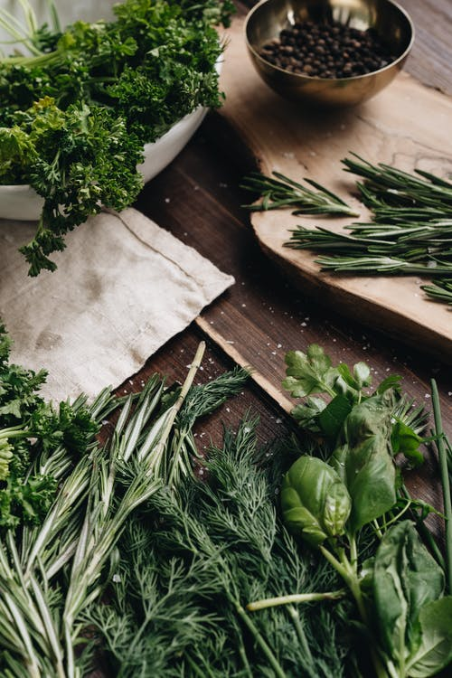 Photo Of Assorted Herbs On Wooden Surface