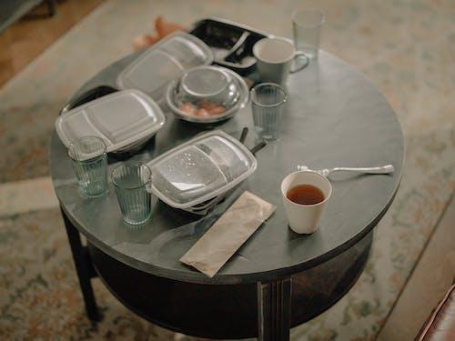 White Ceramic Bowl on Black Wooden Table