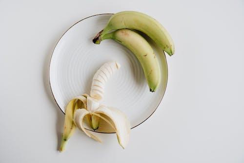 Yellow Banana on White Ceramic Plate