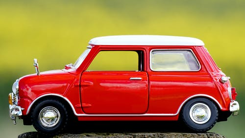 Photo of Red Miniature Toy Car