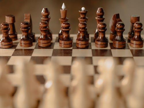 Brown Chess Piece on Chess Board