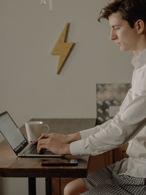 Man in White Dress Shirt Holding Black Tablet Computer