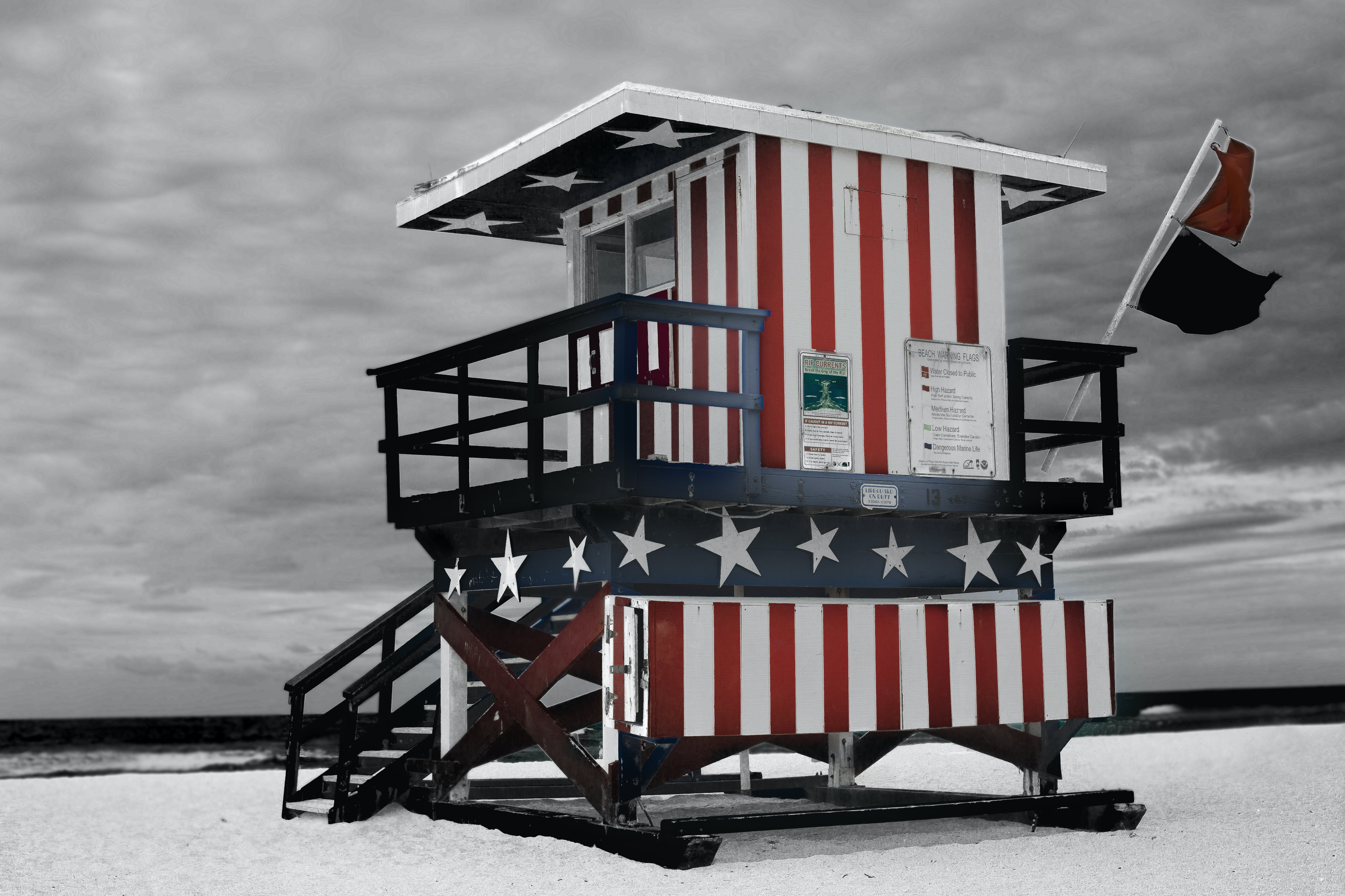 Red and Blue Striped Shed on Sand