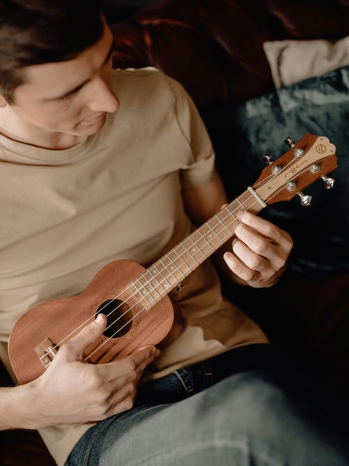 Man in White Crew Neck T-shirt Playing Brown Acoustic Guitar