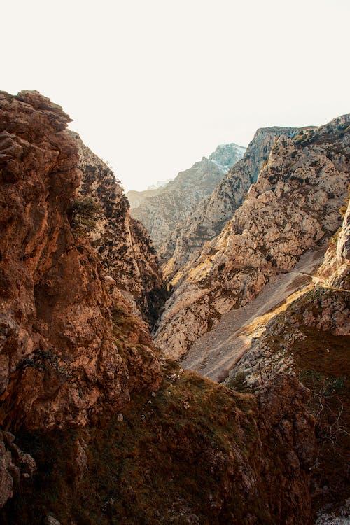 Rocks in valley in sunlight