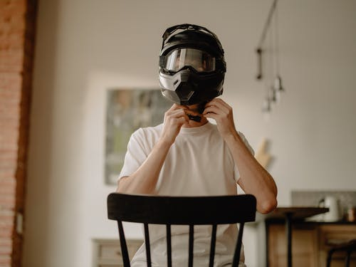 Man in White Shirt Wearing Black Helmet