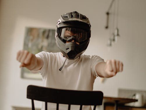 Man in White Long Sleeve Shirt Wearing Black Helmet