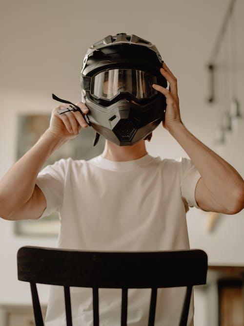 Man in White Crew Neck T-shirt Wearing Black Helmet