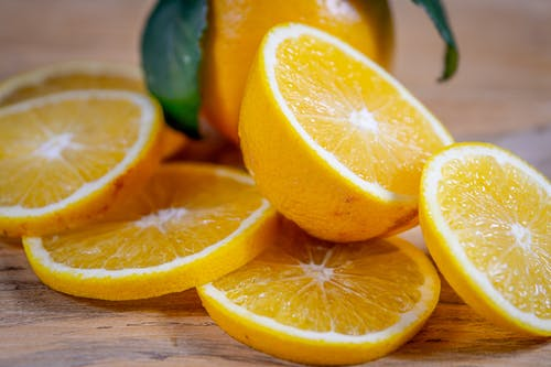 Orange Slices on a Brown Wooden Table