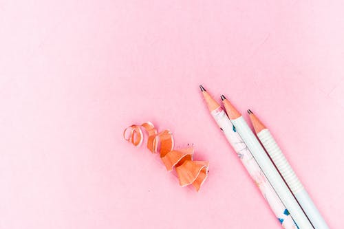 Close-Up Shot of Pencils on a Pink Surface