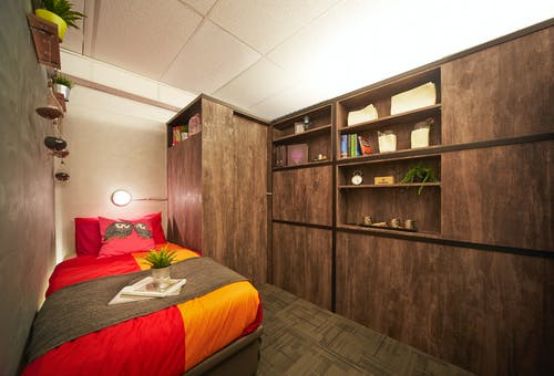 Small room with bed and cupboard