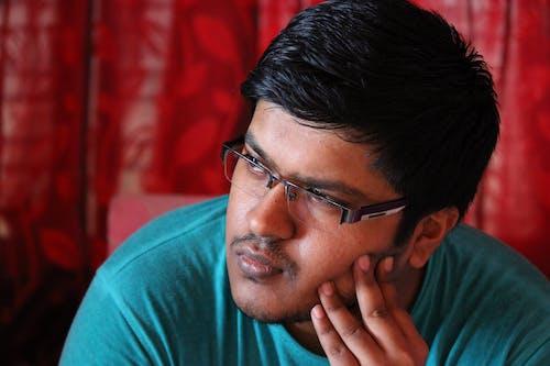 Man in Green Crew Neck Shirt Wearing Black Framed Eyeglasses