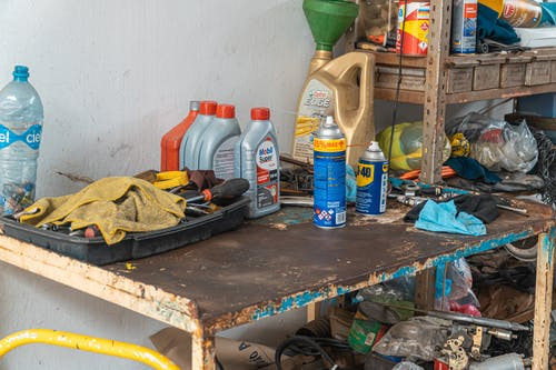 Automotive Oil Containers On A Rusty Table