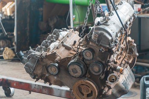 Car Engine Being Lifted By Chain