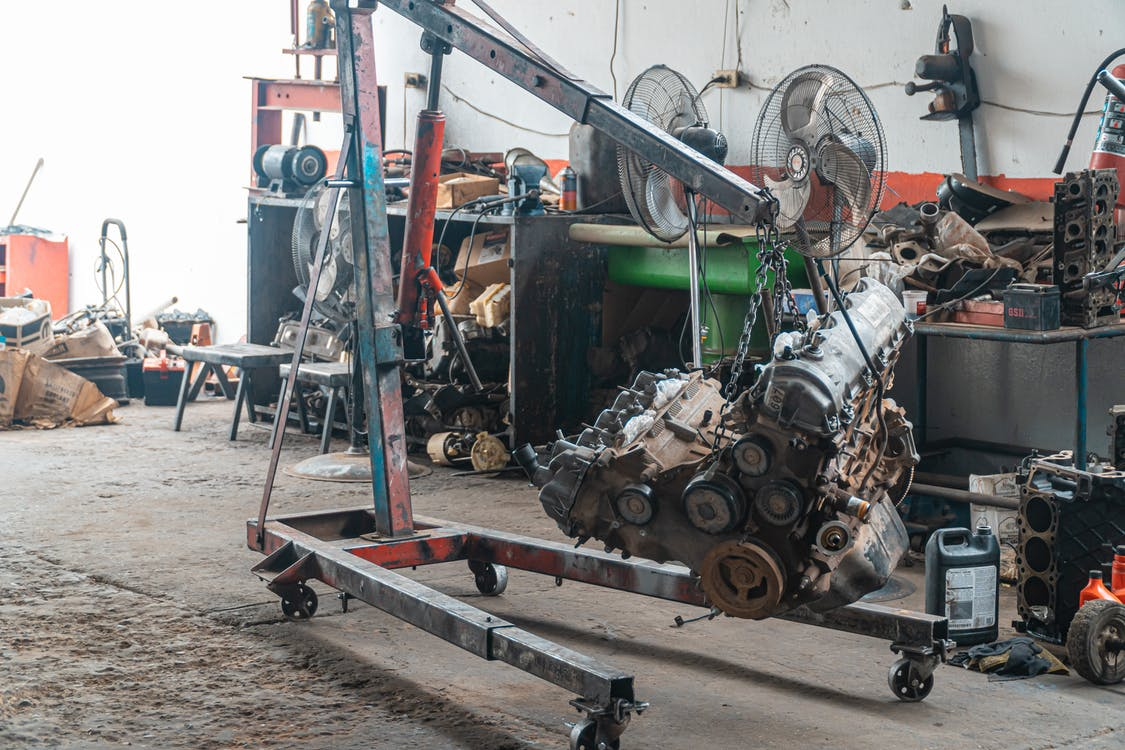 Car Engine Being Lifted With Chain