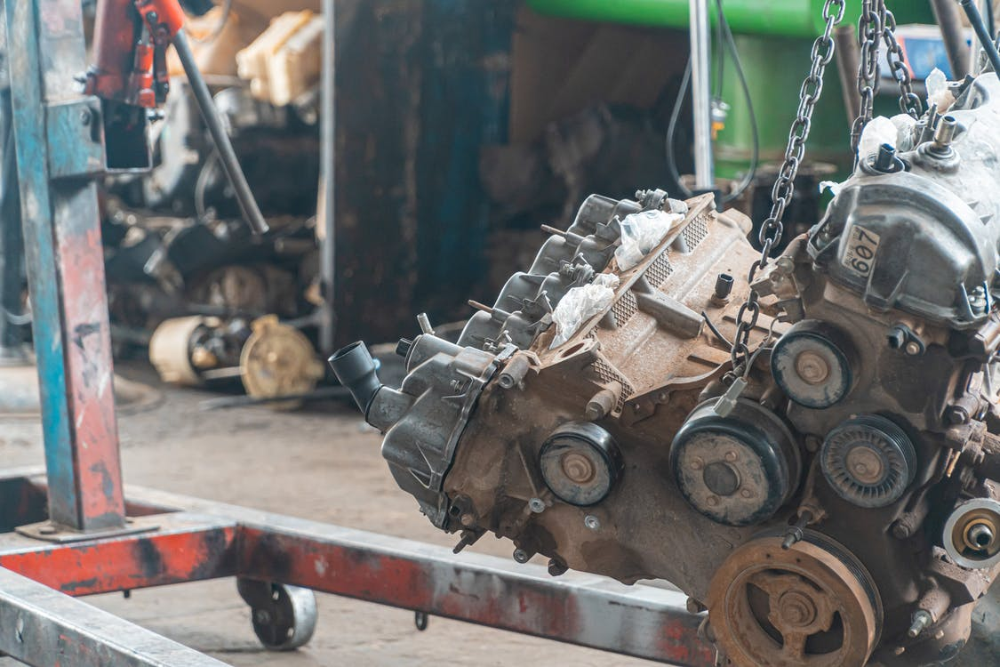 Car Engine Lifted By Chain