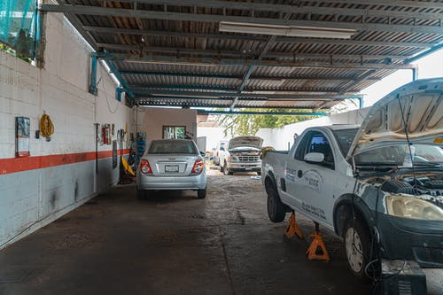 White Crew Cab Pickup Truck Parked Beside White Van