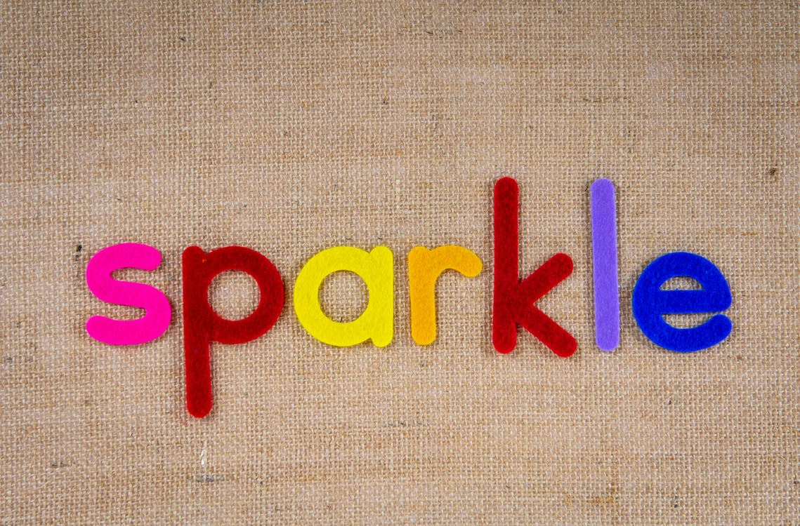 Colorful Cutouts Of The Word Sparkle