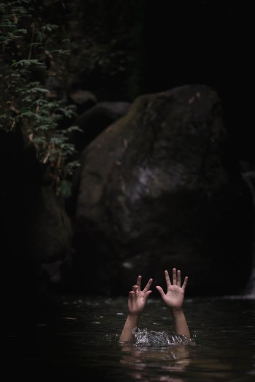 Person Underwater With Hands Up On Air
