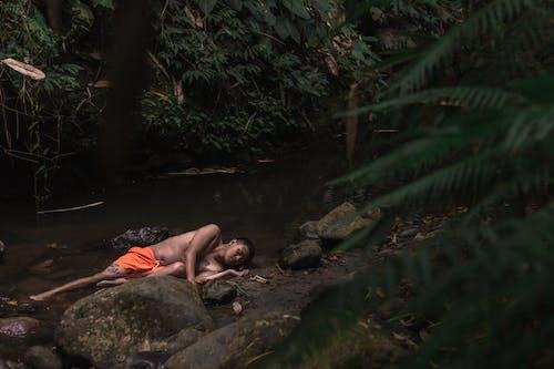 Photo Of Man Laying On Riverside