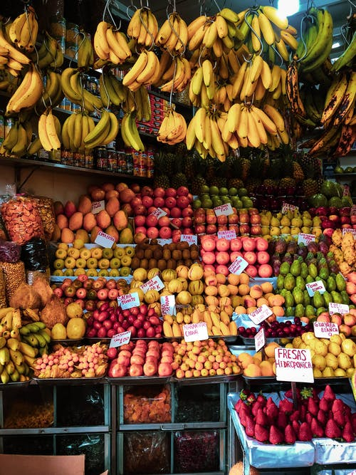 Photo of Assorted Fruits Selling on Fruit Stand