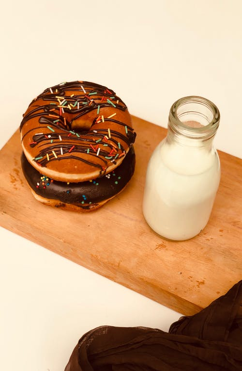Close-Up Photo Of Doughnuts On Chopping Board