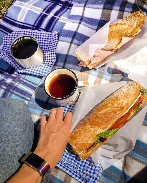Two Sandwiches Beside White Ceramic Mug