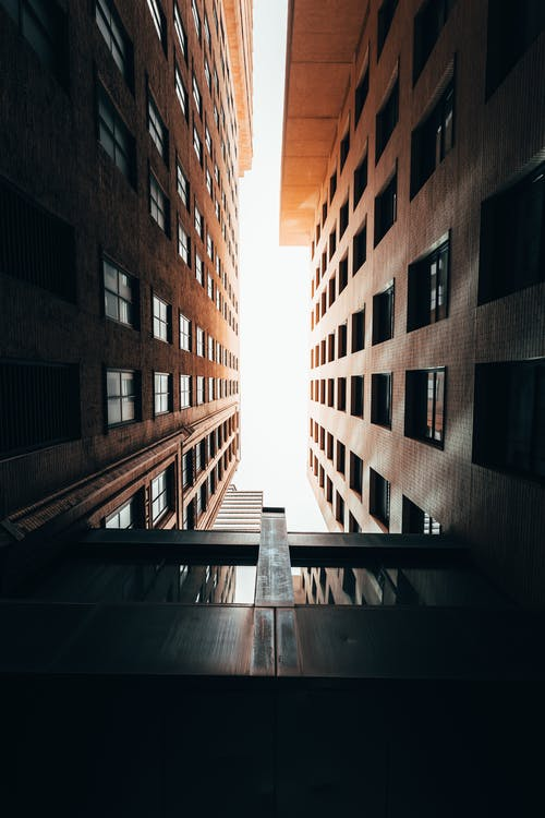 Low Angle Photography Of Brown Concrete Buildings