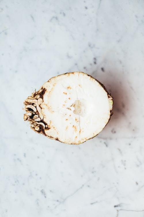 White Round Fruit on White Surface