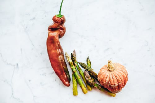 Red Chili and Garlic on White Table