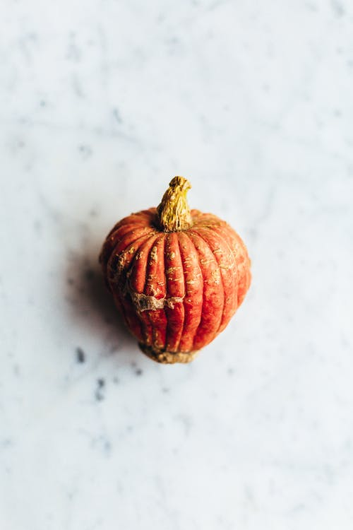 Photo of Orange Pumpkin on White Table