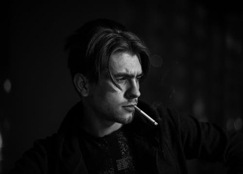 Monochrome Photo Of Man Smoking Cigarette