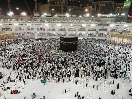 Muslim people visiting Kaaba sacred site
