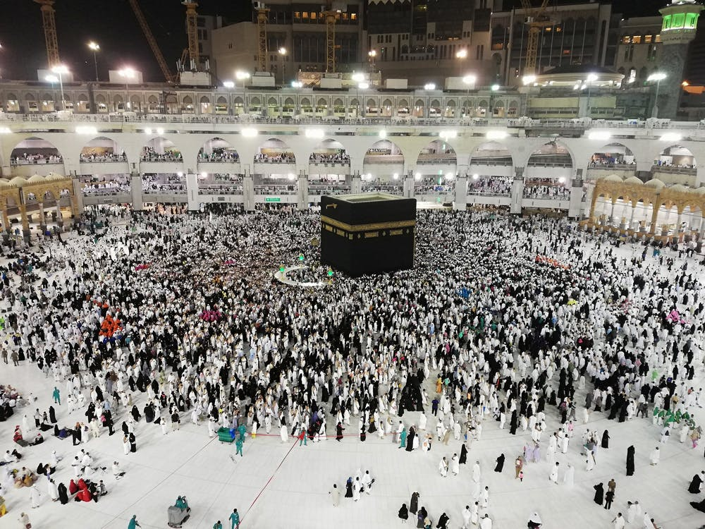 From above of crowded square around Kaaba cube in Great Mosque of Mecca at night time