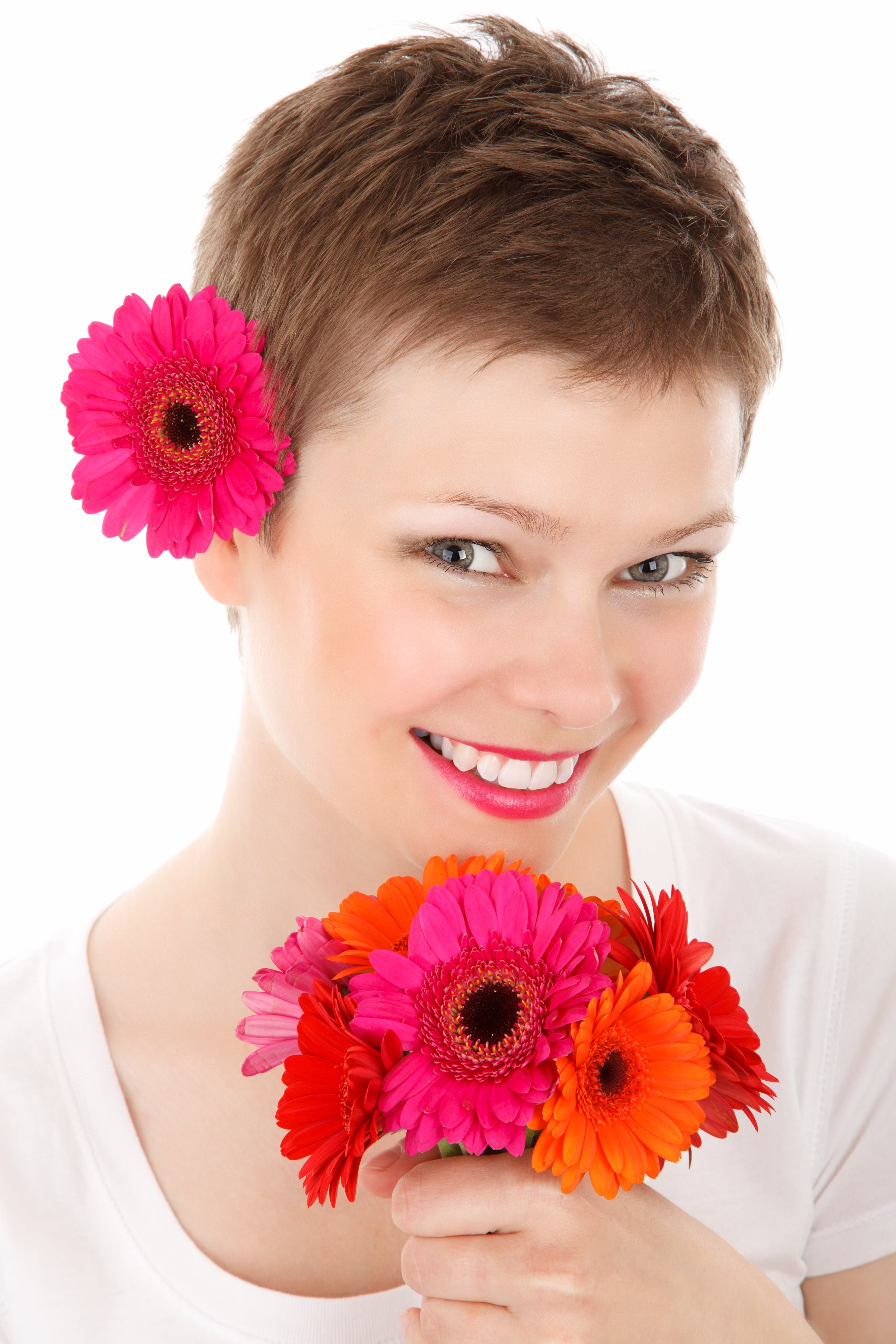 Woman Holding Flowers While Smiling