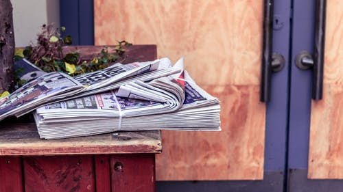 Stack of Newspaper on Table