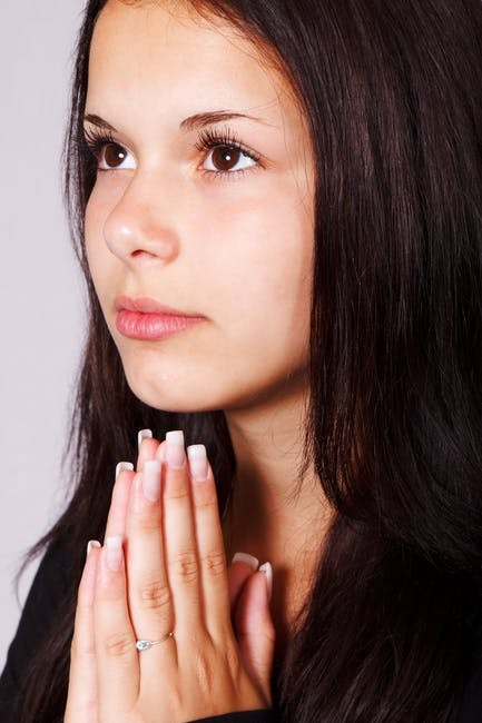 photo of young dark-haired girl praying
