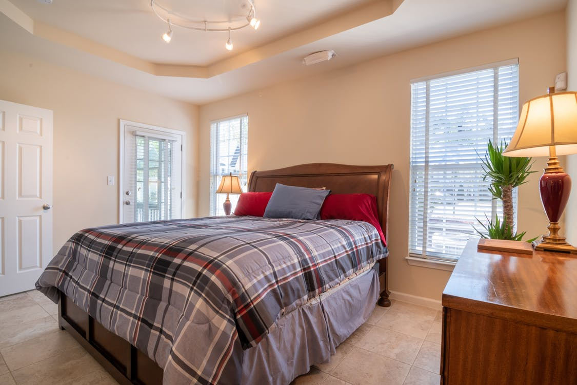 Bedroom With Plaided Bed Linen