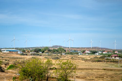 Photo of Wind Turbines Under Blue Sky