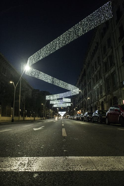 Illuminating decorations above urban road at night