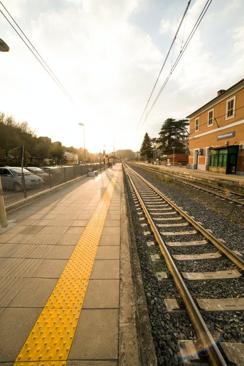 Outdoor railway platform in urban environment