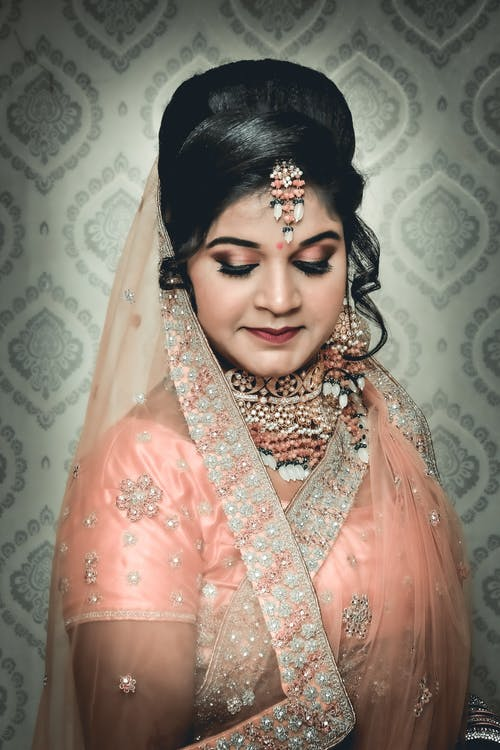 Photo Of Woman Wearing Pink Veil