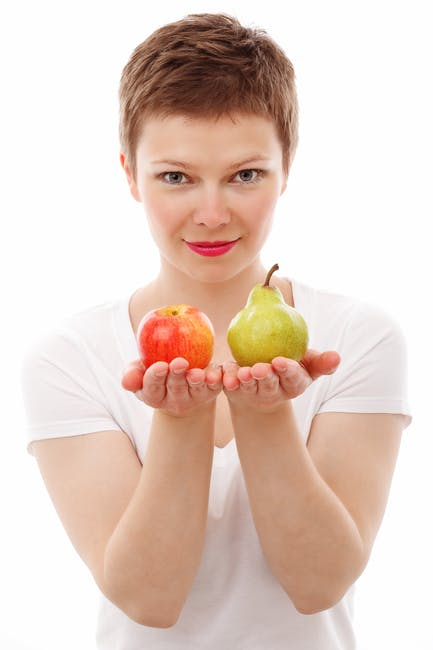 Woman Holding Red Apple and Green Peach
