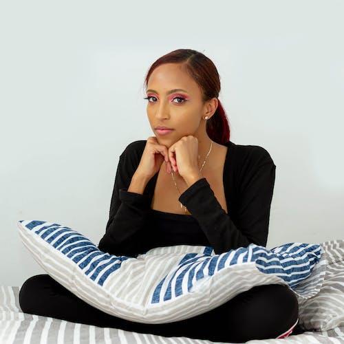 Photo Of Woman Wearing Black Sweater
