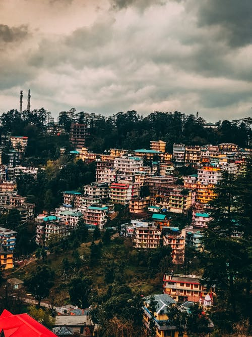 Free stock photo of city, clouds, colorful houses