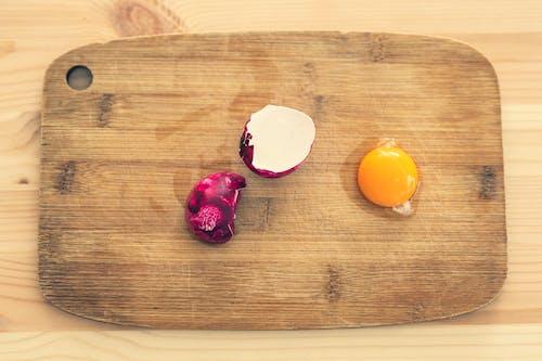 Photo Of Egg Yolk On Wooden Chopping Board