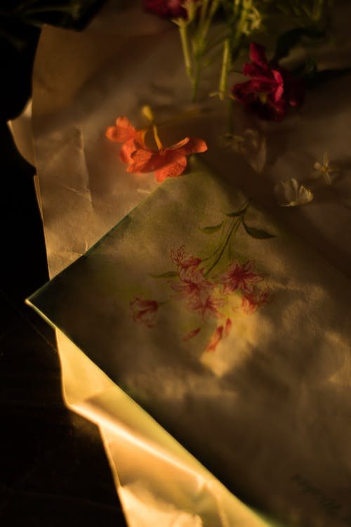 Delicate colorful flowers on table with envelope