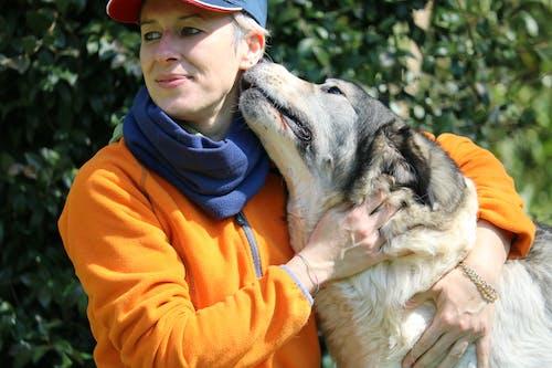 Photo Of Woman Hugging Dog