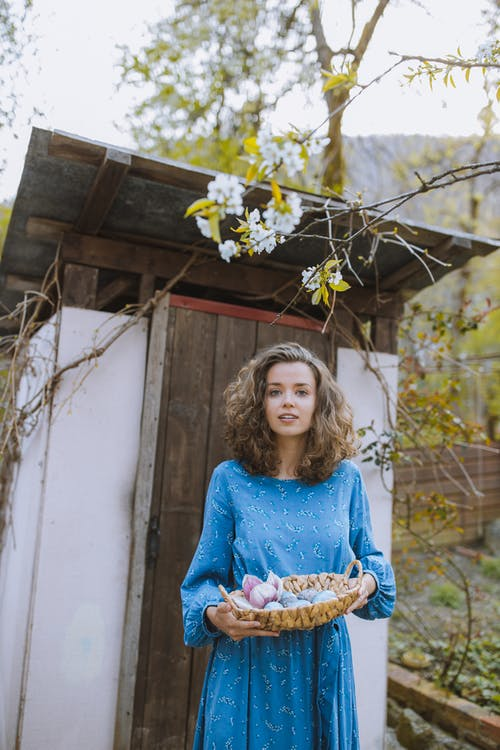 Woman With a Basket of Easter Eggs